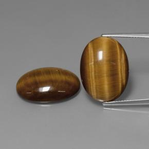 10.45 ct كابوشون بيضاوى Medium Brown عين النمر حجر كريم 19.49 mm x 14.5 mm (معرف المنتج: 390094)